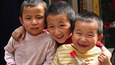 China raises the limit of two children in a family to three